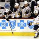 Buffalo Sabres center Tyler Ennis (63) celebrates with teammates after scoring a goal against the Chicago Blackhawks during the first period of an NHL hockey game in Chicago, Saturday, Oct. 11, 2014 The Associated Press