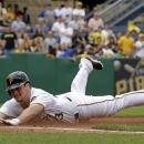 Pittsburgh Pirates' Travis Snider dives safely into third with an RBI-triple during the second inning of a baseball game against the Chicago Cubs in Pittsburgh, Thursday, May 23, 2013.  (AP Photo/Gene J. Puskar)