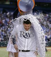 Tampa Bay Rays' Jose Lobaton is doused by teammate Yunel Escobar after his walkoff ninth-inning RBI-triple off Toronto Blue Jays relief pitcher Aaron Loup scored Escobar during a baseball game on Friday, Aug. 16, 2013, in St. Petersburg, Fla. The Rays won the game 5-4. (AP Photo/Chris O'Meara)