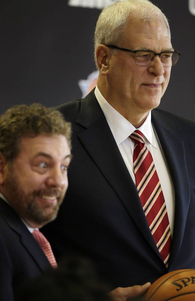 James Dolan, left, executive chairman of  Madison Square Garden, smiles as he introduces Phil Jackson as the new president of the New York Knicks, Tuesday, March 18, 2014 in New York. Jackson, who won two NBA titles as a player for the New York Knicks, also won 11 championships while coaching the Chicago Bulls and the Los Angeles Lakers