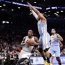 Denver Nuggets guard Randy Foye (4) defends as Brooklyn Nets guard Tyshawn Taylor looks for his shot in the first half of an NBA basketball game Tuesday, Dec. 3, 2013, in New York The Associated Press