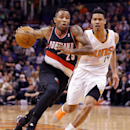 Portland Trail Blazers' Mo Williams (25) drives against Phoenix Suns' Gerald Green (14) during the first half of an NBA basketball game, Wednesday, Nov. 27, 2013, in Phoenix The Associated Press
