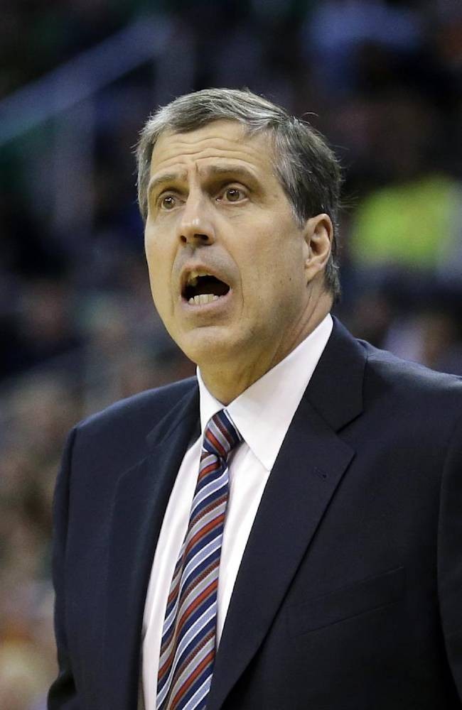 Washington Wizards coach Randy Wittman shouts to his team during the second quarter of an NBA basketball game against the Utah Jazz on Saturday, Jan. 25, 2014, in Salt Lake City