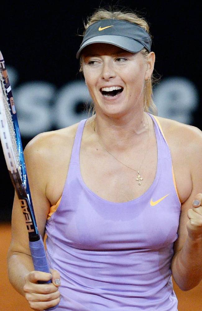 Russia's Maria Sharapova celebrates after winning her semifinal match against Sara Errani of Italy at the Porsche tennis Grand Prix in Stuttgart, Germany, Saturday, April 26, 2014. Sharapova won the match with 6-1 and 6-2