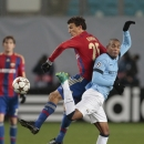 Manchester City's Vincent Kompany, right, battles for the ball with CSKA's Roman Eremenko during the Champions League Group E soccer match between CSKA Moscow and Manchester City at Arena Khimki stadium in Moscow, Russia, Tuesday Oct. 21, 2014