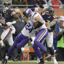Minnesota Vikings safety Harrison Smith intercepts a pass thrown by Chicago Bears quarterback Jay Cutler as Bears running back Matt Forte (22) tried to stop him during the second half of an NFL football game Sunday, Nov. 16, 2014 in Chicago. At left is Mi