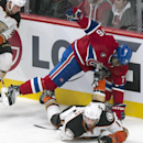 Anaheim Ducks' Ryan Kesler's skate gets caught in Montreal Canadiens' P.K. Subban's jersey during the first period of an NHL hockey game, Thursday, Dec. 18, 2014, in Montreal The Associated Press