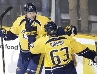 Nashville Predators center Craig Smith (15) celebrates with Mike Ribeiro (63) after Smith scored against the Los Angeles Kings in the first period of an NHL hockey game Tuesday, Nov. 25, 2014, in Nashville, Tenn. (AP Photo/Mark Humphrey)