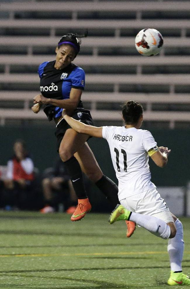 Seattle Reign FC's Sydney Leroux, left, tries to head-in a shot as Washington Spirit's Ali Krieger defends in the first half of a NWSL semifinal soccer match Sunday, Aug. 24, 2014, in Seattle