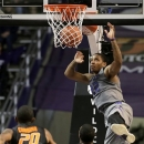 Kansas State guard Rodney McGruder (22) gets past Oklahoma State forward Michael Cobbins (20) and guard Marcus Smart (33) to dunk the ball during the first half of an NCAA college basketball game, Saturday, Jan. 5, 2013, in Manhattan, Kan. (AP Photo/Charlie Riedel)