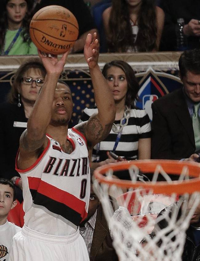 In this photo taken Saturday, Feb. 15, 2014, Portland Blazers' Damian Lillard competes in the three-point shot contest during the skills competition at the NBA All Star basketball game in New Orleans. Orleans. Portland guard Damian Lillard became the first player to participate in all five competitions during the NBA All-Star weekend. The Trail Blazers guard participated in Friday's rising stars games between first- and second-year players, Saturday's three skill competitions and Sunday's All-Star game