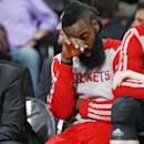 Houston Rockets guard James Harden sits on bench with his left ankle wrapped in bandages during the third quarter of the Denver Nuggets' 123-116 victory in an NBA basketball game in Denver on Wednesday, April 9, 2014 The Associated Press