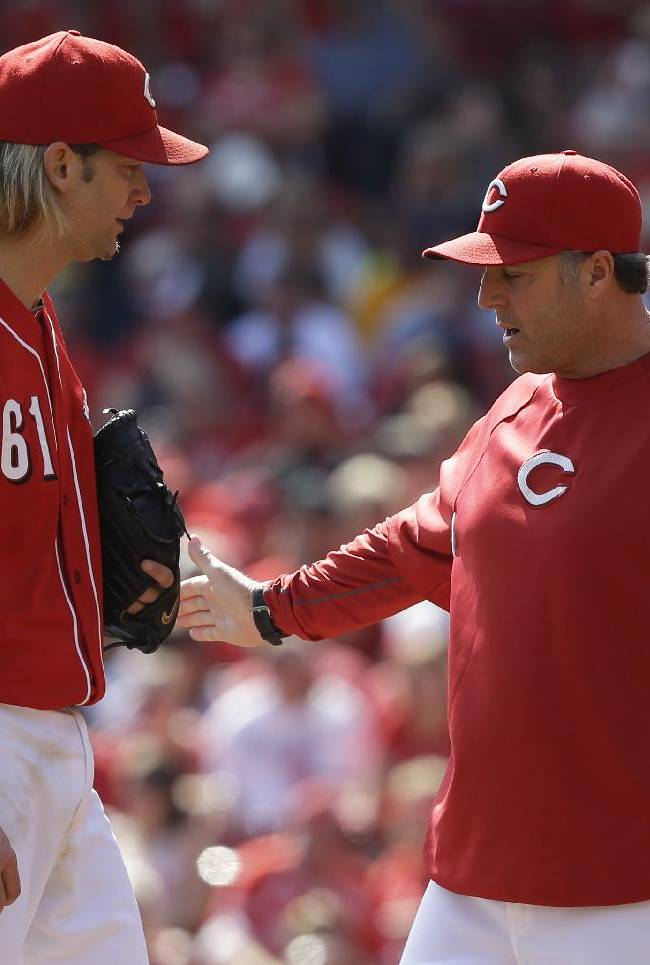 Cincinnati Reds starting pitcher Bronson Arroyo (61) talks with pitching coach Bryan Price during the third inning of a baseball game against the Pittsburgh Pirates, Saturday, Sept. 28, 2013, in Cincinnati