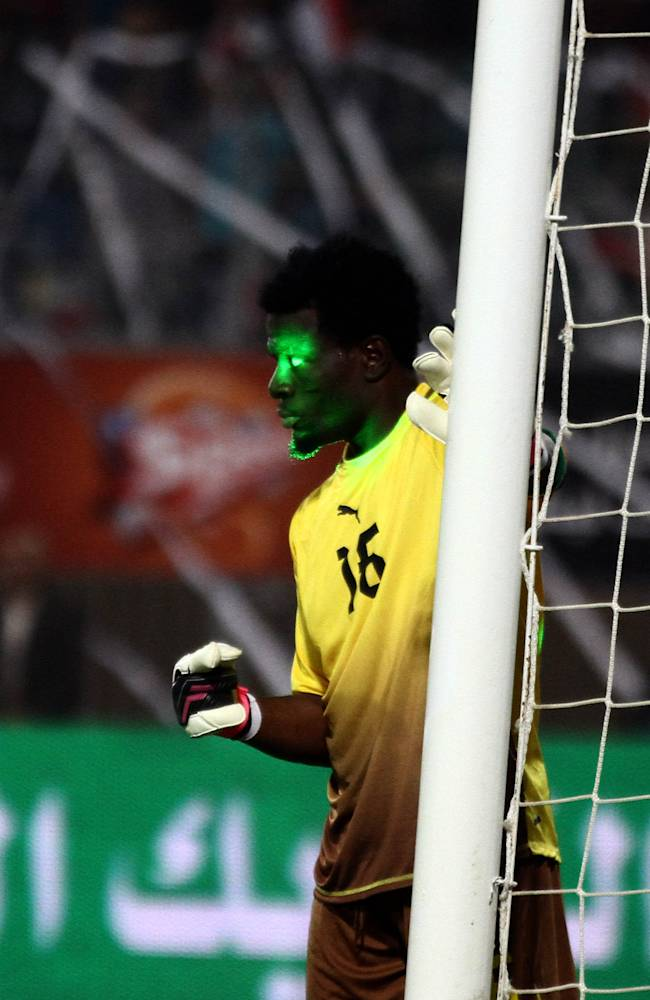 A green laser from an Egypt fan shines in the eyes of Ghana goal keeper Abdul Fatawu Dauda during the World Cup qualifying playoff second leg soccer match between Ghana and Egypt, at the Air Defense Stadium in Cairo, Egypt, Tuesday, Nov. 19, 2013. Ghana qualified for the World Cup on Tuesday with a 7-3 aggregate win over Egypt in the playoffs to seize the fourth of five African places available at the finals. Egypt won the second leg 2-1 in the first international in Cairo in two years but Ghana progressed because of its 6-1 win at home in the first leg last month _ when Egypt's dream of making a World Cup for the first time since 1990 effectively ended