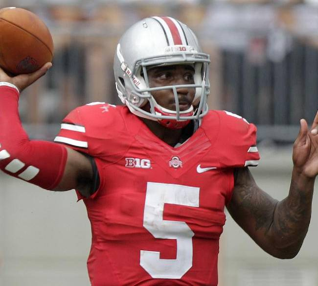In this Aug. 31, 2013, file photo, Ohio State quarterback Braxton Miller throws a pass against Buffalo during an NCAA college football game in Columbus, Ohio. Miller is expected to start for the Buckeyes at No. 16 Northwestern this Saturday