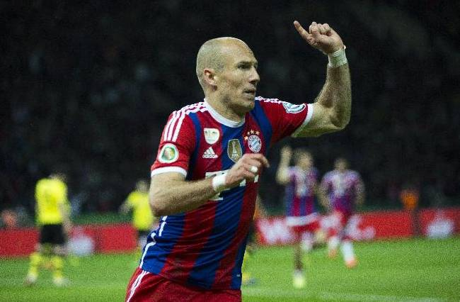 Bayern's Arjen Robben of the Netherlands celebrates scoring his side's first goal during the German Soccer Cup Final between FC Bayern Munich and Borussia Dortmund at the Olympic Stadium in Berlin, Germany, Saturday, May 17, 2014
