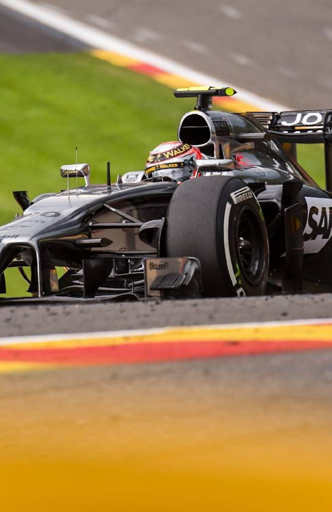 McLaren driver Kevin Magnussen of Denmark steers his car during the second practice session ahead of Sunday's Belgian Formula One Grand Prix in Spa-Francorchamps, Belgium, Friday, Aug. 22, 2014