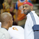 CLEVELAND, OH - OCTOBER 14: LeBron James #23 of the Cleveland Cavaliers talks with a referee during the first half against the Milwaukee Bucks at Quicken Loans Arena on October 14, 2014 in Cleveland, Ohio. User expressly acknowledges and agrees that, by downloading and or using this photograph, User is consenting to the terms and conditions of the Getty Images License Agreement. (Photo by Jason Miller/Getty Images)
