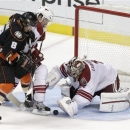 Phoenix Coyotes goalie Jason LaBarbera, blocks a shot by Anaheim Ducks right wing Teemu Selanne, left, with the help of Zbyne