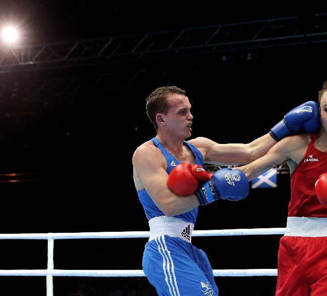 Wales Sean McGoldrick, left, lands a punch on Australia's Jackson Woods in the Men's bantamweight preliminaries bout at the Commonwealth Games Glasgow 2014, in Glasgow, Scotland, Monday July 28, 2014