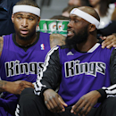 After falling into foul trouble, Sacramento Kings center DeMarcus Cousins, left, talks with forward Reggie Evans in the first half of an NBA basketball game against the Denver Nuggets in Denver, Sunday, Feb. 23, 2014 The Associated Press