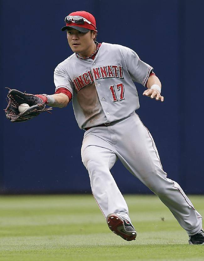 In this July 14, 2013, photo, Cincinnati Reds center fielder Shin-Soo Choo fields the ball during a baseball game against the Atlanta Braves in Atlanta. The Rangers have made another Texas-sized deal to improve their offense. Free agent outfielder Choo agreed to a $130 million, seven-year contract with the Rangers, a person familiar with the deal told The Associated Press on Saturday, Dec. 21, 2013