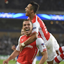 Arsenal's Alexis Sanchez, right, hugs his teammate Lukas Podolski after Podolski scored 2-1 during the Group D Champions League match between Anderlecht and Arsenal at Constant Vanden Stock Stadium in Brussels, Belgium, Wednesday Oct. 22, 2014