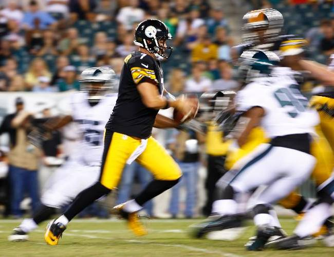 In this image made with a slow shutter speed, Pittsburgh Steelers' Ben Roethlisberger rushes during the second half of an NFL preseason football game against the Philadelphia Eagles, Thursday, Aug. 21, 2014, in Philadelphia