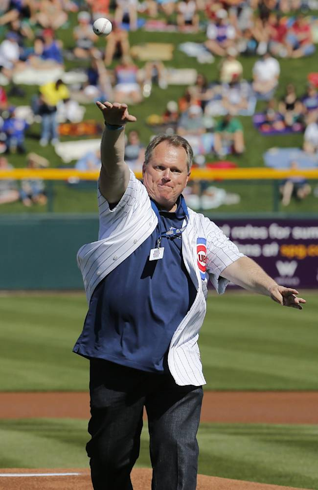 Mesa, Ariz., Mayor Scott Smith throws out the first pitch prior to the spring training baseball game between the Arizona Diamondbacks and the Chicago Cubs on Thursday, Feb. 27, 2014, in Mesa. It was the Cubs' first Cactus League game in their new spring training facility
