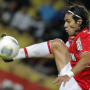 FILE - This is a Friday, Nov. 8, 2013 file photo of Monaco's Radamel Falcao of Colombia as he controls the ball during his French League One soccer match against Evian, in Monaco stadium. Radamel Falcao is set to join Manchester United on loan after the P