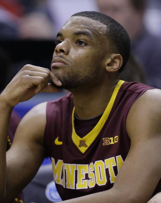 Minnesota guard Andre Hollins watches from the bench in the second half of an NCAA college basketball game against Wisconsin in the quarterfinals of the Big Ten Conference tournament Friday, March 14, 2014, in Indianapolis. Wisconsin won 83-57