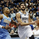 Minnesota Timberwolves' Ricky Rubio, right, of Spain, lays up a shot as Denver Nuggets's Randy Foye defends in the first quarter of an NBA basketball game Wednesday, Feb. 12, 2014, in Minneapolis The Associated Press