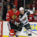 Minnesota Wild's Charlie Coyle, right, and Chicago Blackhawks' Marian Hossa (81) go for the puck in the first period of an NHL hockey game in Chicago, Thursday, April 3, 2014 The Associated Press