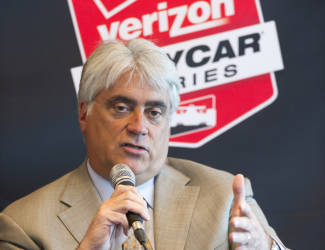 Mark Miles, Chief Executive Officer, Hulman & Company, answers a reporter's question during IndyCar Media Day at the Indianapolis Motor Speedway in Indianapolis Tuesday, Feb. 17, 2015. (AP Photo/Doug McSchooler)