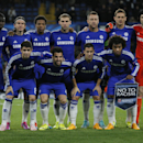 Chelsea players line up for a team photo prior to the Group G Champions League match between Chelsea and Maribor at Stamford Bridge stadium in London, Britain, Tuesday, Oct. 21, 2014