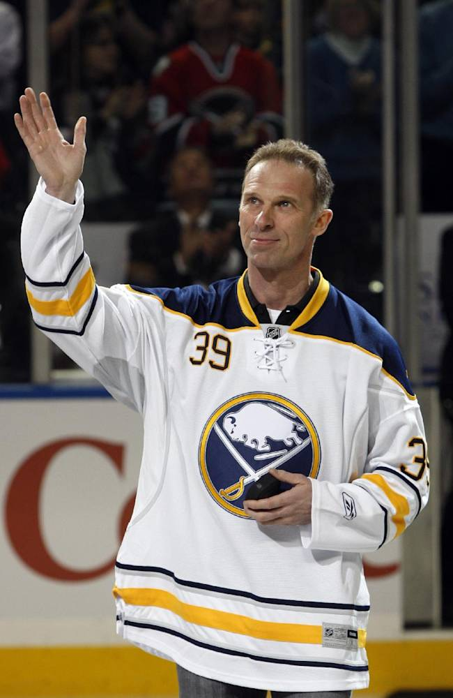 Buffalo Sabres former goalie Dominik Hasek waves to the fans during a pre-game ceremony before an NHL hockey game against the Atlanta Thrashers in Buffalo, N.Y., Saturday, March 19, 2011