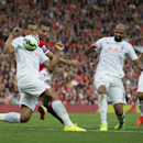 Manchester United's Robin van Persie, second left, attempts to force the ball past Queens Park Rangers' Steven Caulker, left, during their English Premier League soccer match at Old Trafford Stadium, Manchester, England, Sunday Sept. 14, 2014