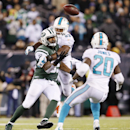 Miami Dolphins outside linebacker Jelani Jenkins (53) disrupts a pass to New York Jets tight end Jeff Cumberland (85) to cause an interception by Miami Dolphins strong safety Reshad Jones (20) with seconds left in the fourth quarter an NFL football game,