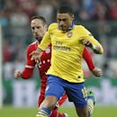 Bayern's Franck Ribery, left, follows Arsenal's Alex Oxlade-Chamberlain during the Champions League round of 16 second leg soccer match between FC Bayern Munich and FC Arsenal in Munich, Germany, Tuesday, March 11, 2014