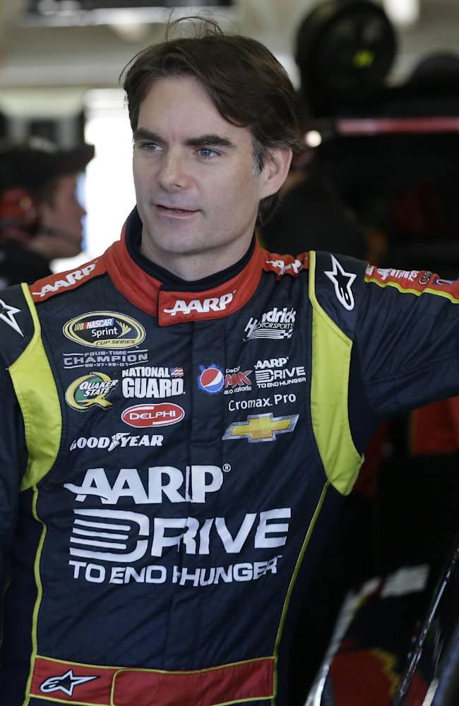 Driver Jeff Gordon stands by his his car in the garage before practice for Sunday's NASCAR Sprint Cup series auto race at the Texas Motor Speedway in Fort Worth, Texas, Friday, Nov. 1, 2013