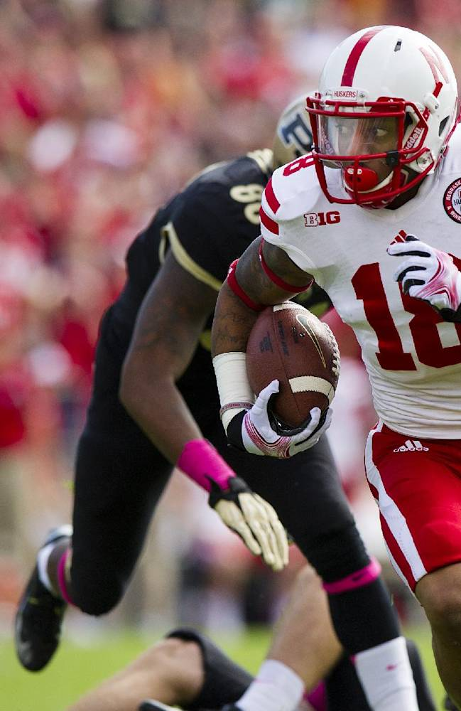 Nebraska's LeRoy Alexander (18) returns an interception against Purdue during the first half of an NCAA college football game, Saturday, Oct. 12, 2013, in West Lafayette, Ind