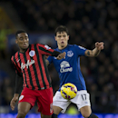 Queens Park Rangers' Leroy Fer, left, fights for the ball against Everton's Muhamed Besic during the English Premier League soccer match between Everton and Queens Park Rangers at Goodison Park Stadium, Liverpool, England, Monday Dec. 15, 2014