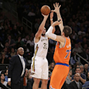New Orleans Pelicans forward Ryan Anderson (33) shoots a three pointer as New York Knicks forward Andrea Bargnani (77) of Italy defends in the first half of their NBA basketball game at Madison Square Garden in New York, Sunday, Dec. 1, 2013 The Associate