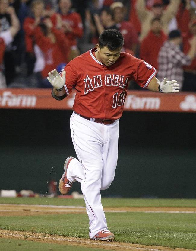 Los Angeles Angels' Hank Conger celebrates after he was hit by a pitch to force Raul Ibanez home to score the game winning run during the 11th inning of a baseball game against the New York Mets on Friday, April 11, 2014, in Anaheim, Calif. The Angels won 5-4