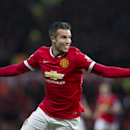 Manchester United's Robin van Persie celebrates after scoring during the English Premier League soccer match between Manchester United and Liverpool at Old Trafford Stadium, Manchester, England, Sunday Dec. 14, 2014