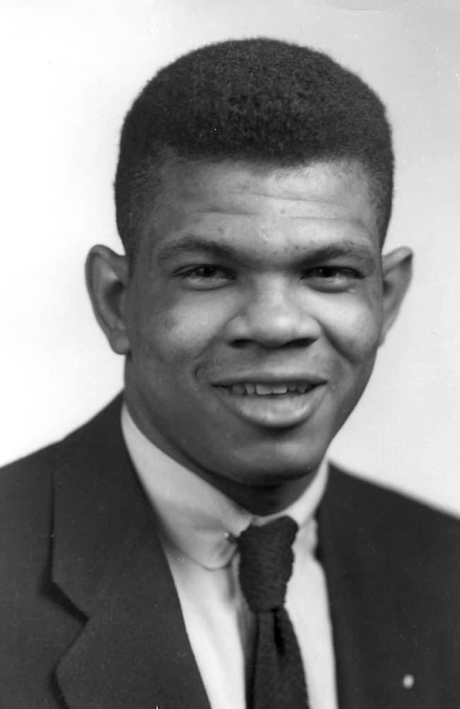 In this undated image provided by the University of Nebraska, Charles Bryant, who in 1953 was among the first two African-Americans to letter for the Huskers since 1913, poses for a photo. On Saturday, Aug. 30, 2014, Brandin Bryant, the grandson of Charles, will play in Lincoln with Florida Atlantic against the Huskers