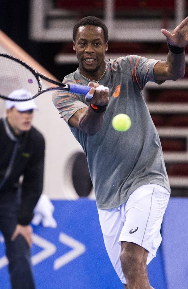 Gael Monfils of France returns the ball to Tommy Haas of Germany during their match at the gala tournament Tennis Classics in Papp Laszlo Sports Arena in Budapest, Hungary, Tuesday, Dec. 3, 2013