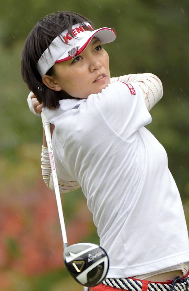 Taiwan's Teresa Lu watches her tee shot on the second hole during the final round of the Mizuno Classic golf tournament in Shima, Mie prefecture, western Japan Sunday, Nov. 10, 2013. Lu won the Mizuno Classic on Sunday