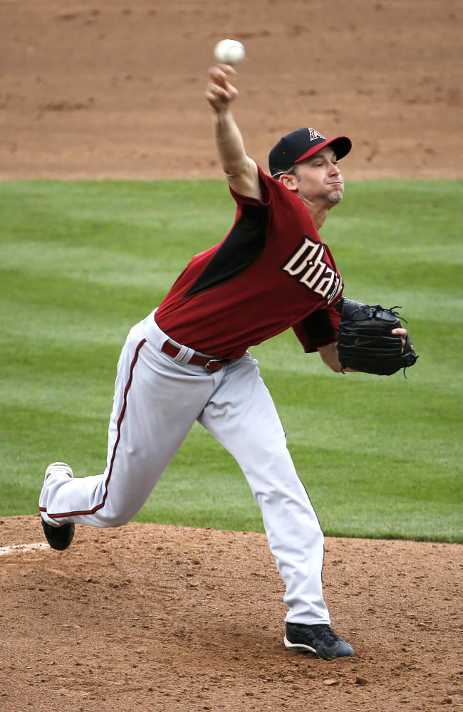 Arizona Diamondbacks pitcher Bronson Arroyo throws against the Chicago Cubs during the second inning of a spring training baseball game on Thursday, Feb. 27, 2014, in Mesa, Ariz