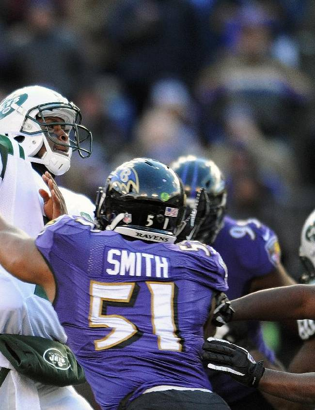 New York Jets quarterback Geno Smith passes the ball under pressure from Baltimore Ravens inside linebacker Daryl Smith (51) during the first half of an NFL football game in Baltimore, Md., Sunday, Nov. 24, 2013